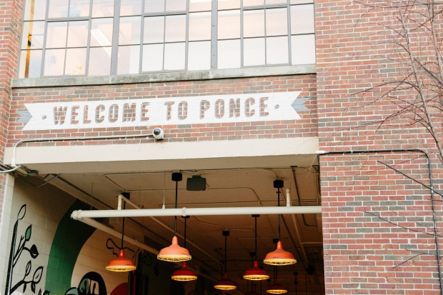 atlanta engagement session welcome to ponce sign ponce city market atlanta wedding photographer casey green photography