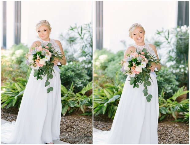 blonde bride in Florida smiling and holding colorful bouquet