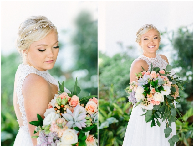 blonde bride smiling and holding a colorful bouquet in front of hotel