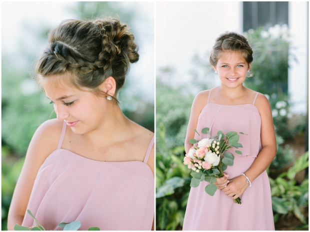 junior bridesmaids a pink dress showing her braided hairstyle